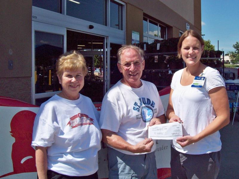 Donation check presented to Mike and Marge for Putt for Life.